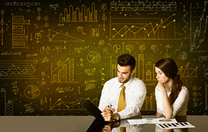Business couple sitting at black table with hand drawn diagram background