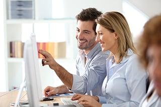 Workteam in office working on desktop computer-4